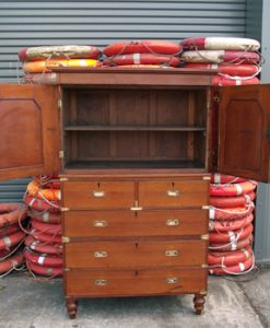 A Campaign Chest of Drawers with Dresser Top